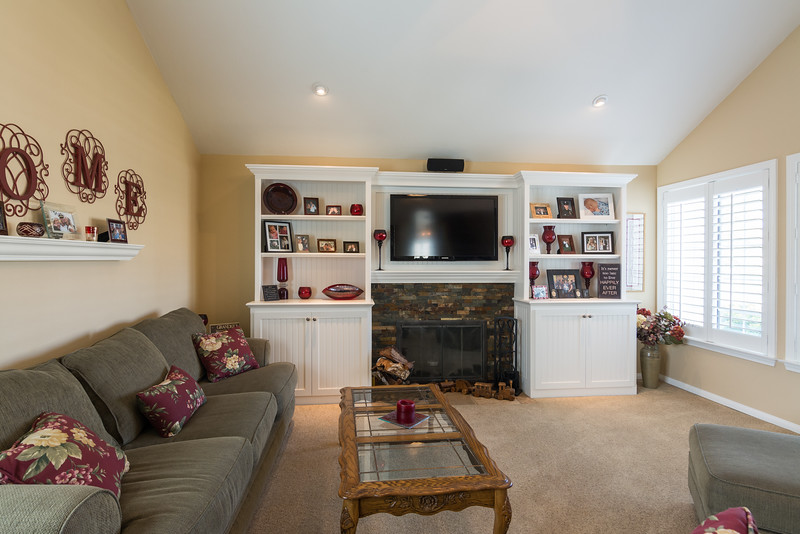 Built-in bookcases and recessed lighting