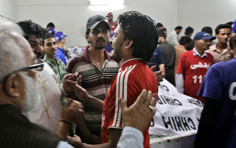 . A Pakistani man, who lost a relative in a bomb blast, reacts at a hospital\'s morgue in Karachi, Pakistan, Sunday, March 3, 2013. Pakistani officials say a bomb blast has killed dozens of people in a neighborhood dominated by Shiite Muslims in the southern city of Karachi. (AP Photo/Fareed Khan)