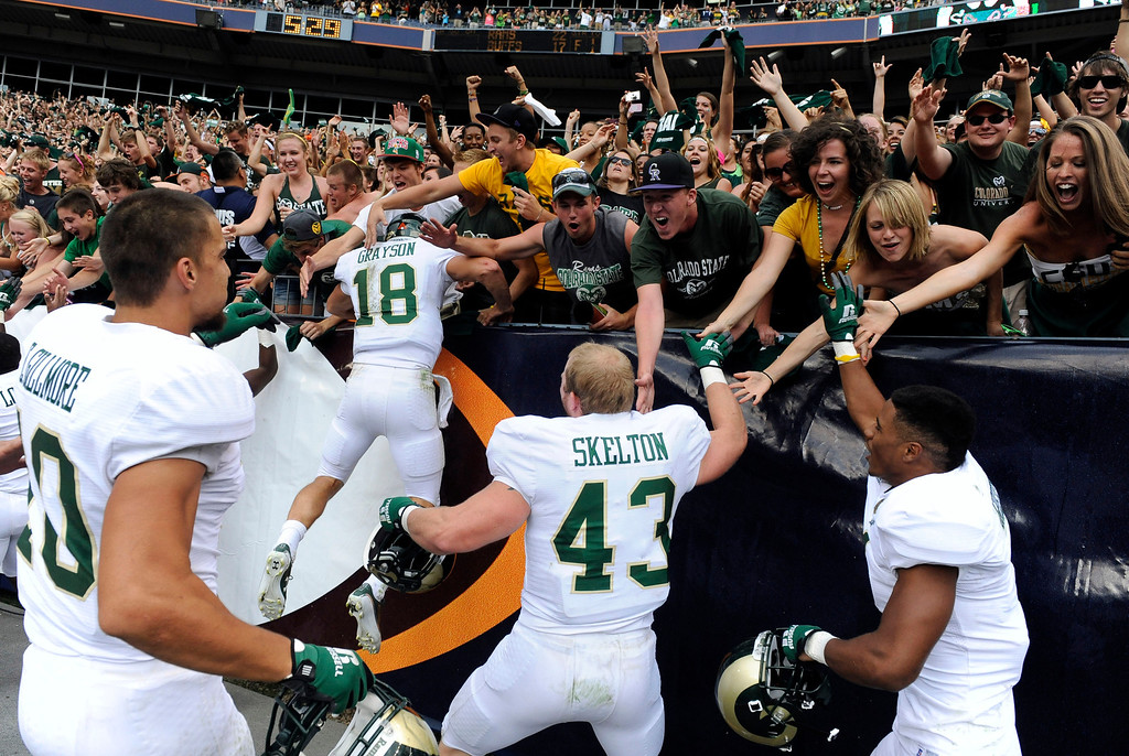 . Colorado State University Rams fans and players celebrate after they defeated Colorado University 22-17 to win the Rocky Mountain Showdown at Sports Authority Field at Mile High Stadium Saturday afternoon September 1, 2012. The Denver Post/ Andy Cross