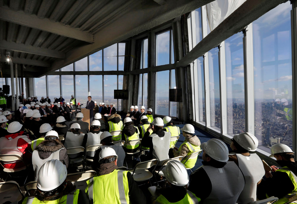 Description of . Port Authority Chairman David Samson, at podium center left, addresses a news conference in observation deck on the 100th floor of the One World Trade Center building, under construction in New York, Tuesday, April 2, 2013. The observation deck will occupy the tower's 100th through 102nd floors. Elevators will whisk visitors to the top in just one minute but the experience of visiting the attraction will take an hour. (AP Photo/Richard Drew)