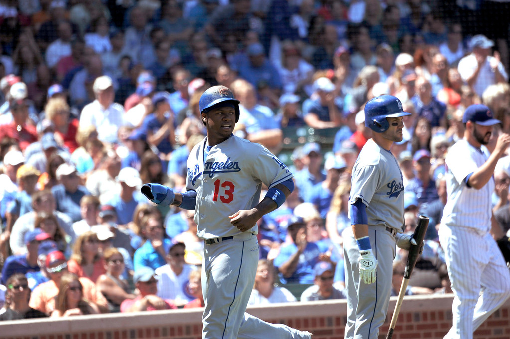 . Los Angeles Dodgers\' Hanley Ramirez reacts after scoring their only run during their 1-0 victory over the Chicago Cubs in a baseball game, Sunday, Aug. 4, 2013, in Chicago. (AP Photo/Joe Raymond)