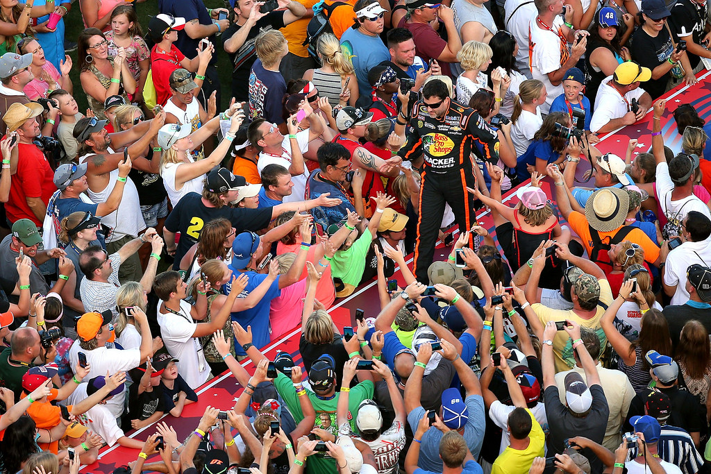 . DAYTONA BEACH, FL - JULY 06:  Tony Stewart, driver of the #14 Bass Pro Shops / Ducks Unlimited Chevrolet, greets fans during driver introductions during the NASCAR Sprint Cup Series Coke Zero 400 at Daytona International Speedway on July 6, 2013 in Daytona Beach, Florida.  (Photo by Mike Ehrmann/Getty Images)