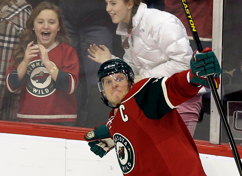 . Minnesota Wild\'s Mikko Koivu, of Finland, celebrates after scoring in the third period of an NHL hockey game against the Colorado Avalanche, Thursday, Feb. 14, 2013, in St. Paul, Minn. The Avalanche won 4-3 in a shootout. (AP Photo/Jim Mone)