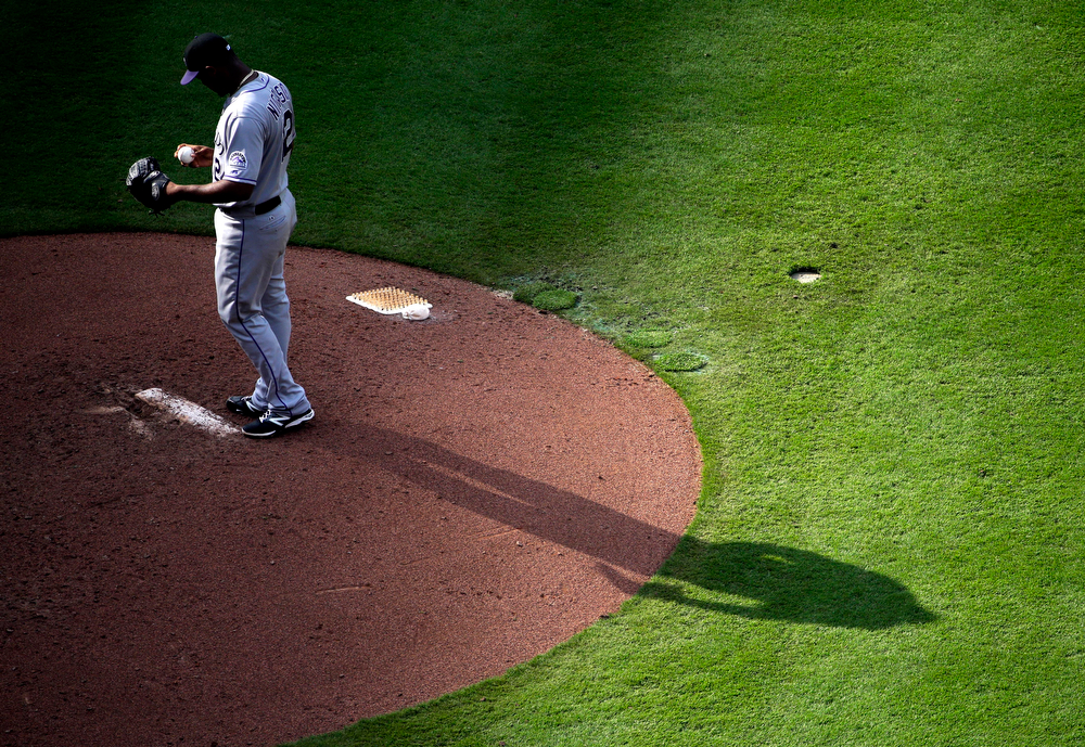 . Colorado Rockies starting pitcher Juan Nicasio stands on the mound as he prepares to throw in the sixth inning of a baseball game against the Atlanta Braves, Saturday, May 24, 2014, in Atlanta. (AP Photo/David Goldman)