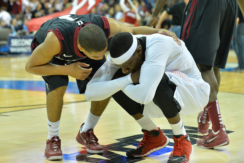 March 20, 2014: Harvard Crimson guard Siyani Chambers (1) talks to Cincinnati Bearcats forward Justin Jackson (5) after a second round game of the NCAA Division I Men's Basketball Championship between the 5-seed Cincinnati Bearcats and the 12-seed Harvard Crimson at Spokane Arena in Spokane, Wash. Harvard defeated Cincinnati 61-57.