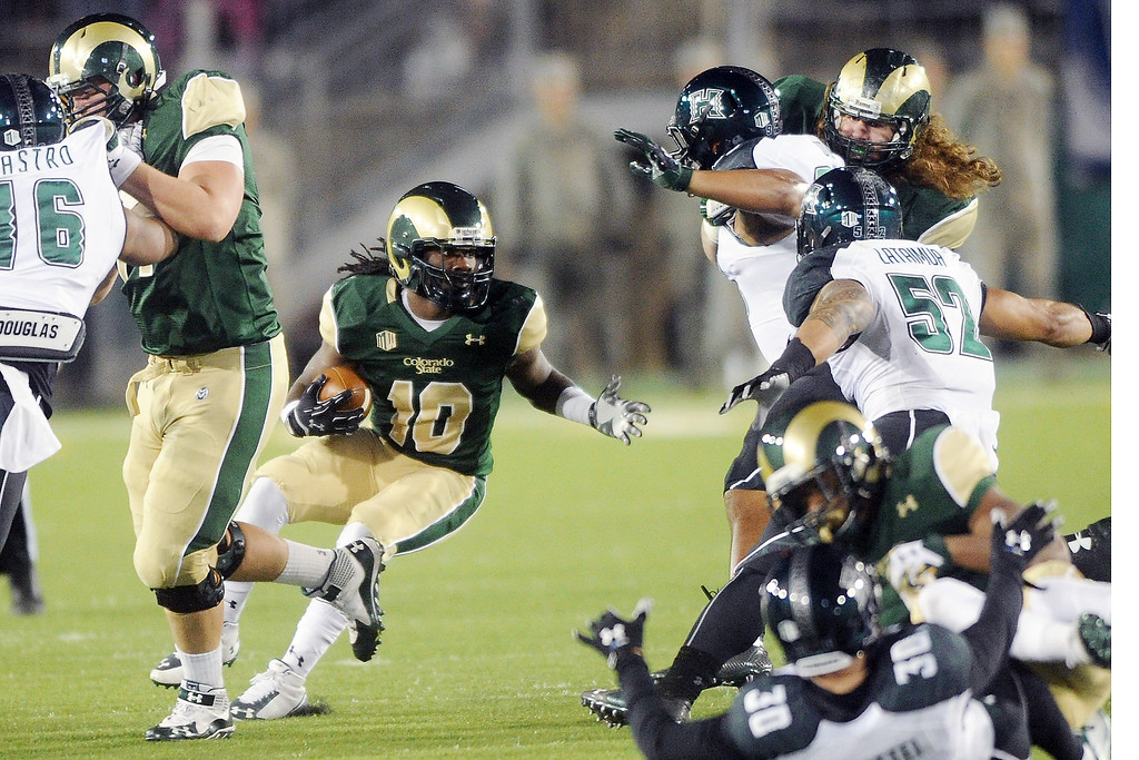. 1109 SPO CSU football_08-srs.jpg Colorado State running back Dee Hart (10) cuts through a hole on a run in the second quarter against Hawaii on Saturday, Nov. 8, 2014, at Hughes Stadium. (Photo by Steve Stoner/Loveland Reporter-Herald)
