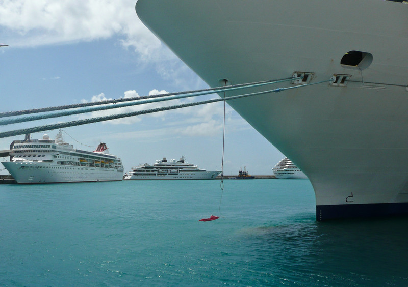 The boat on the left is a cruise ship, the smaller one is a private yacht. Notice the helicopter on the back.