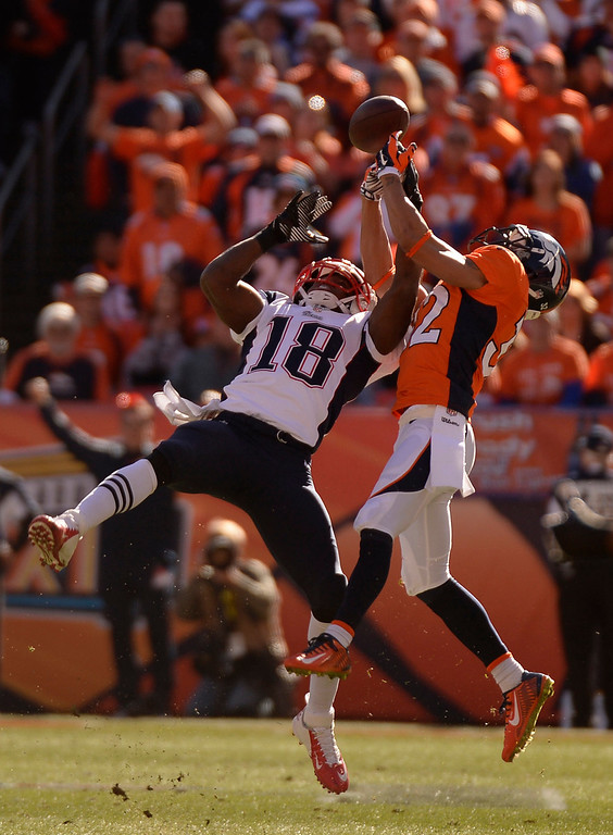 . Denver Broncos cornerback Tony Carter (32) breaks up a pass intended for New England Patriots wide receiver Matthew Slater (18) during the first quarter. The Denver Broncos vs. The New England Patriots in an AFC Championship game  at Sports Authority Field at Mile High in Denver on January 19, 2014. (Photo by John Leyba/The Denver Post)