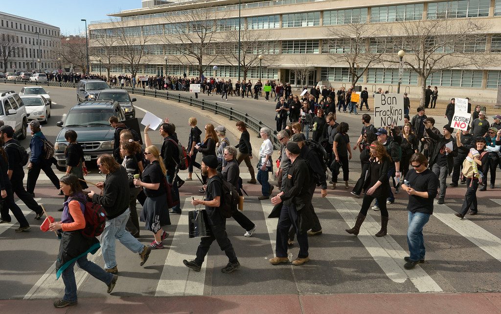 . DENVER, CO- FEBRUARY 17:   The protestors, all of whom wore black for the march, walk towards Civic Center park during the rally.    A few hundred people from a coalition of students, faith-based organizations, indigenous, political, and environmental groups marched from the Denver Auraria campus and ended in a rally at Civic Center Park on February 17th, 2013.  The march, called the #ForwardOnClimate Solidarity March and rally, organized by the Sierra Club, 350.org and GoFossilFree.org,  coincided with tens of thousands of protestors, who converged on Washington, DC for the largest climate rally in history. Denver was one of 18 cities hosting major actions to show solidarity with the DC event.    (Photo By Helen H. Richardson/ The Denver Post)