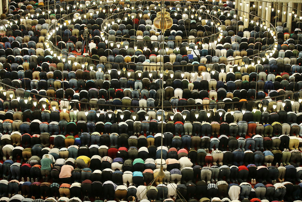 . Turkey\'s Muslims offer prayers during the first day of Eid al-Fitr, which marks the end of the holy fasting month of Ramadan at the Suleymaniye Mosque in Istanbul, early Friday, June 15, 2018. (AP Photo/Emrah Gurel)