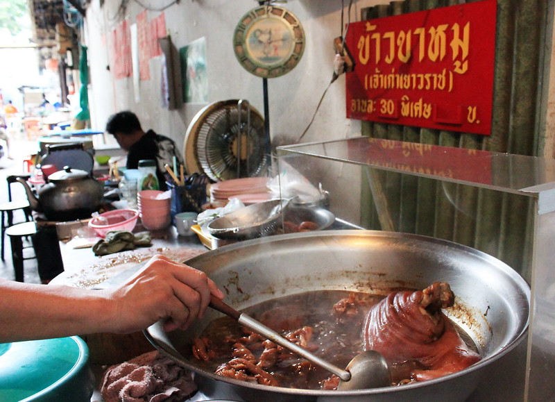 Serving up stewed pig's leg in Bangkok's Chinatown