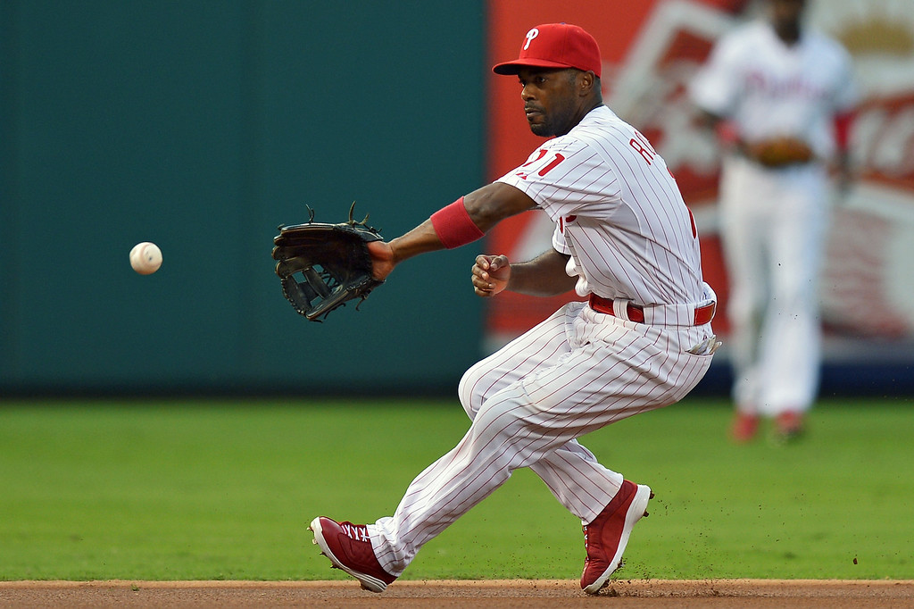 . Jimmy Rollins #11 of the Philadelphia Phillies fields the ball in the first inning against the Colorado Rockies at Citizens Bank Park on August 20, 2013 in Philadelphia, Pennsylvania. (Photo by Drew Hallowell/Getty Images)