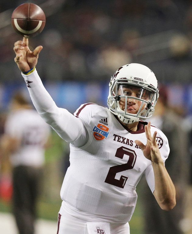 . Texas A&M quarterback Johnny Manziel warms up before the Cotton Bowl NCAA college football game against Oklahoma at Cowboys Stadium on Friday, Jan. 4, 2013, in Irving, Texas. (AP Photo/LM Otero)