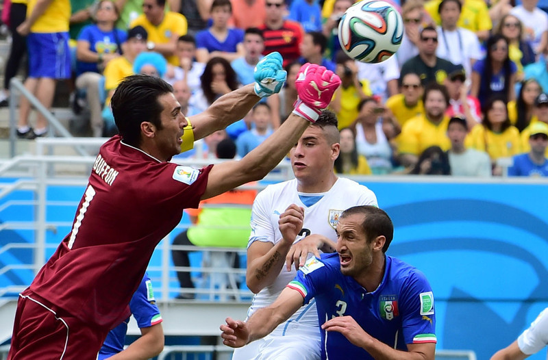 . Italy\'s goalkeeper and captain Gianluigi Buffon (L) clears the ball during the Group D football match between Italy and Uruguay at the Dunas Arena in Natal during the 2014 FIFA World Cup on June 24, 2014.  GIUSEPPE CACACE/AFP/Getty Images