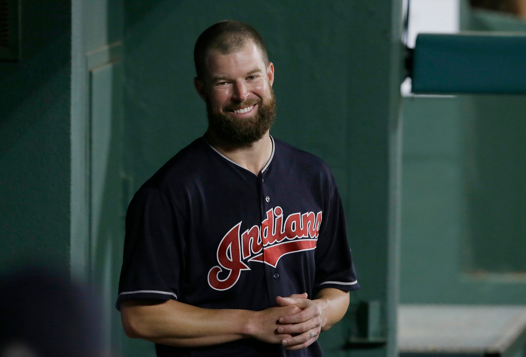 . Cleveland Indians starting pitcher Corey Kluber smiles while standing in the dugout during a baseball game against the Texas Rangers in Arlington, Texas, Friday, Aug. 26, 2016. The Indians won 12-1. (AP Photo/LM Otero)
