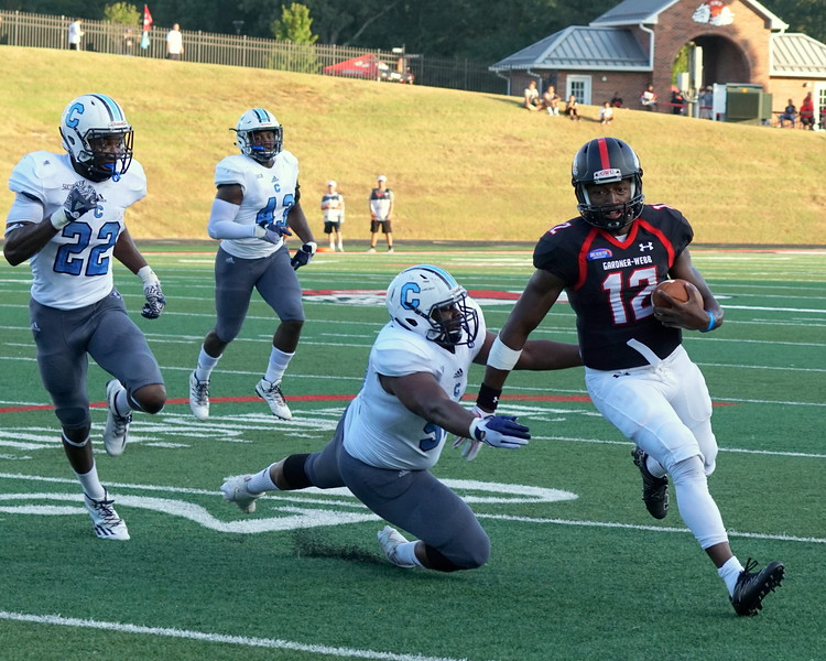 Number 12,  Tyrell Maxwell, evades a Citadel player.