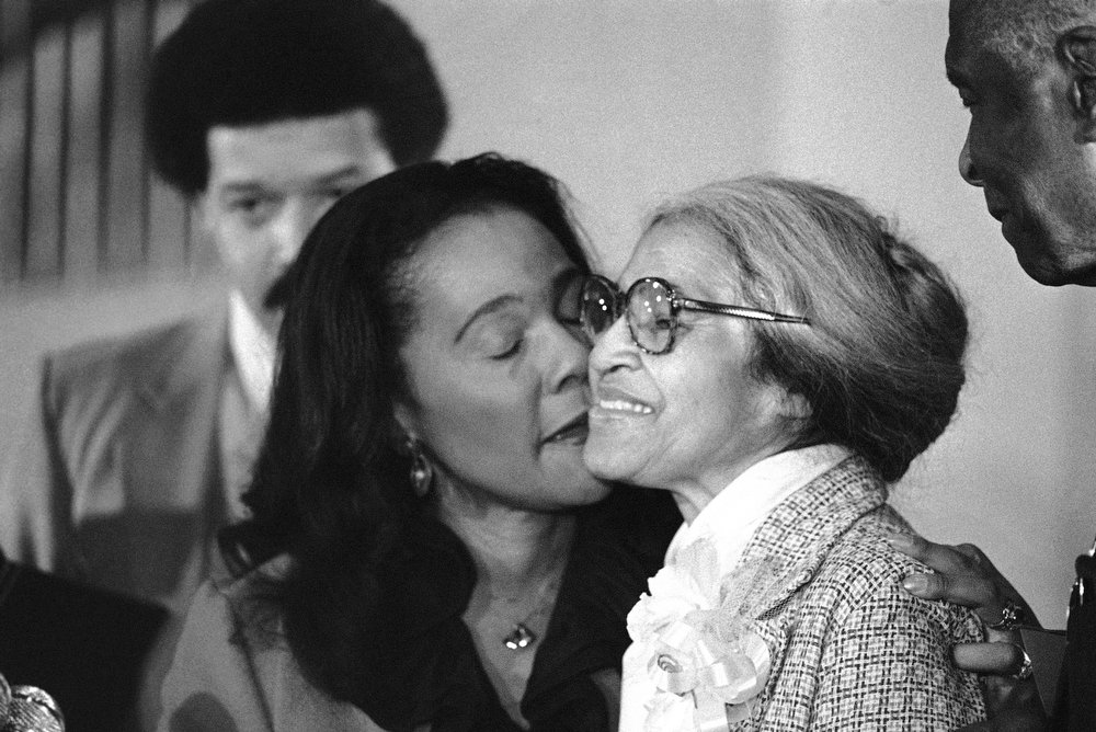 Description of . Rosa Parks, right, is kissed by Coretta Scott King, as she received the Martin Luther King, Jr. Non-violent Peace Prize in Atlanta, Jan. 14, 1980. Parks, who refused to give up her seat on a Montgomery, Ala., bus nearly 25 years ago, is the first woman to win the award. (AP Photo)