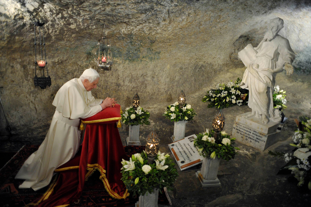 Description of . Pope Benedict XVI prays inside St Paul's Grotto in Rabat, outside Valletta, in this April 17, 2010 file photo. Pope Benedict said on February 11, 2013 he will resign on Feb 28 because he no longer has the strength to fulfill the duties of his office, becoming the first pontiff since the Middle Ages to take such a step. REUTERS/Osservatore Romano/Files