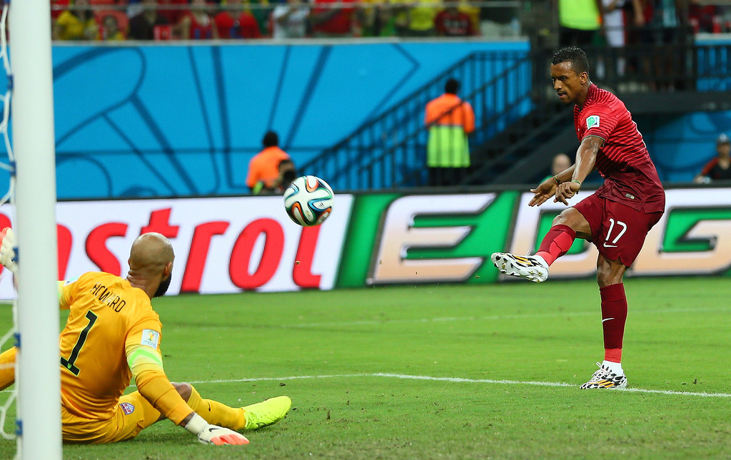 . Nani of Portugal scores his team\'s first goal past goalkeeper Tim Howard of the United States during the 2014 FIFA World Cup Brazil Group G match between the United States and Portugal at Arena Amazonia on June 22, 2014 in Manaus, Brazil.  (Photo by Kevin C. Cox/Getty Images)