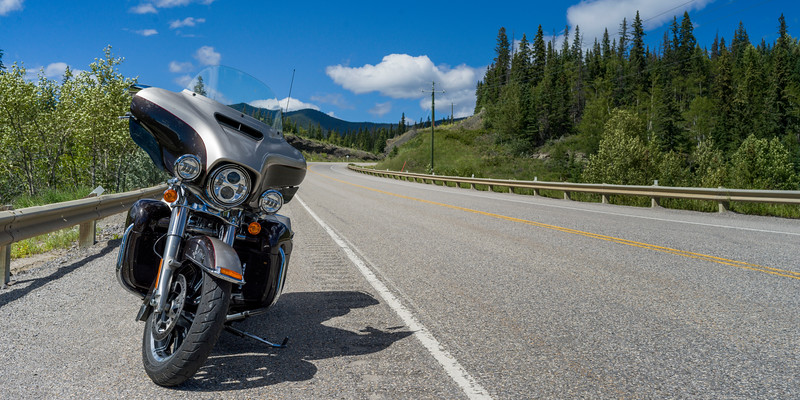 Motorcycle parked at roadside, David Thompson Highway, Clearwater County, Alberta, Canada