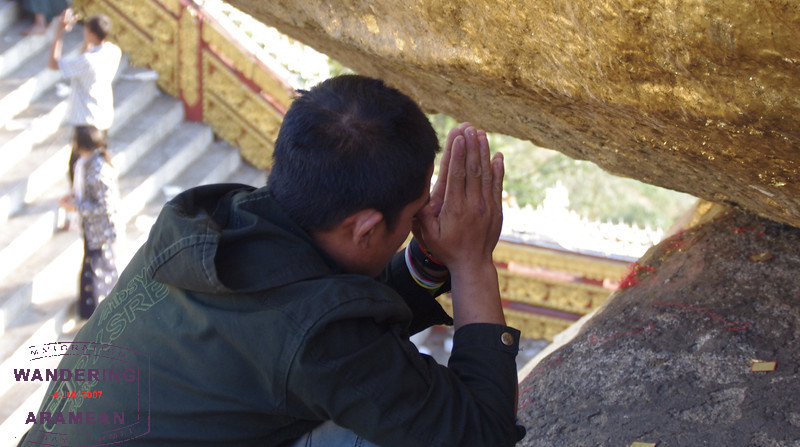 One of many pilgrims praying at the site.