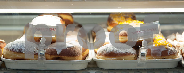 02/06/18 Wesley Bunnell | Staff Display cases with freshly made desserts including paczki on the bottom row at Roly Poly Bakery on Tuesday afternoon.