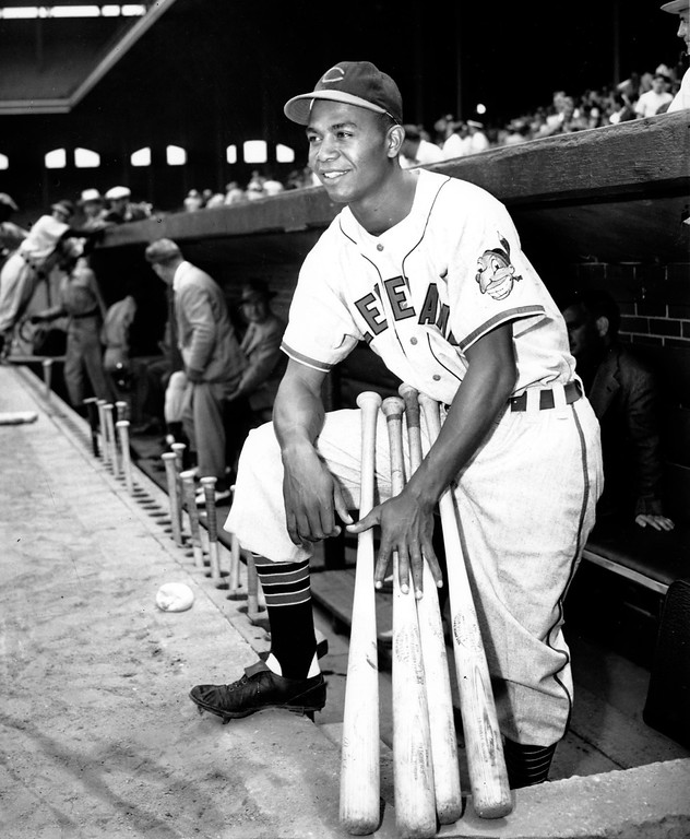 . Larry Doby, first black in the American League, poses proudly in his Cleveland Indians uniform in the dugout in Comiskey Park in Chicago, Ill., on July 5, 1947.  (AP Photo)