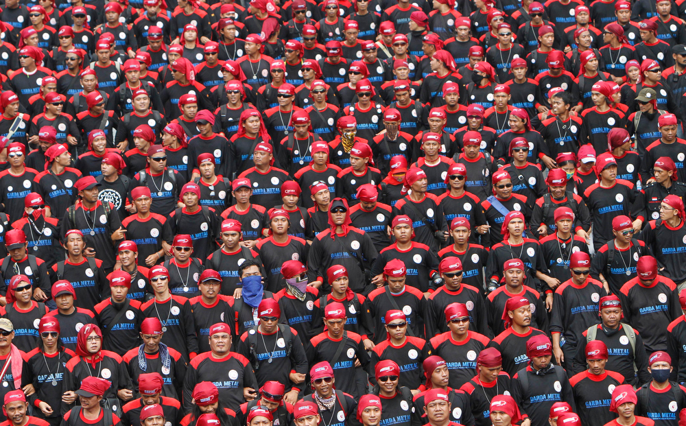 Description of . Workers march during a May Day rally in Jakarta, Indonesia, Wednesday, May 1, 2013. (AP Photo/Tatan Syuflana)