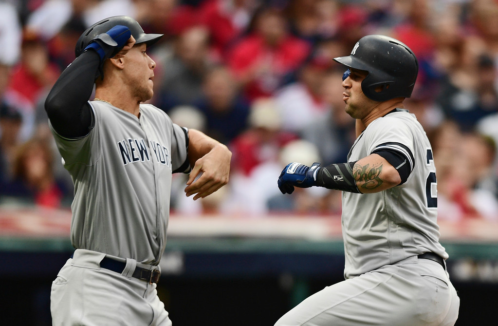 . New York Yankees\' Gary Sanchez, right, is congratulated by Aaron Judge after Sanchez hit a two run home run in the first inning of Game 2 of baseball\'s American League Division Series against the Cleveland Indians, Friday, Oct. 6, 2017, in Cleveland. Judge scored on the play. (AP Photo/David Dermer)