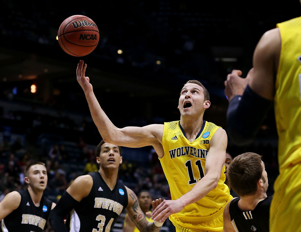 . Nik Stauskas #11 of the Michigan Wolverines shoots against Lee Skinner #34 of the Wofford Terriers in the first half during the second round of the 2014 NCAA Men\'s Basketball Tournament at BMO Harris Bradley Center on March 20, 2014 in Milwaukee, Wisconsin.  (Photo by Jonathan Daniel/Getty Images)
