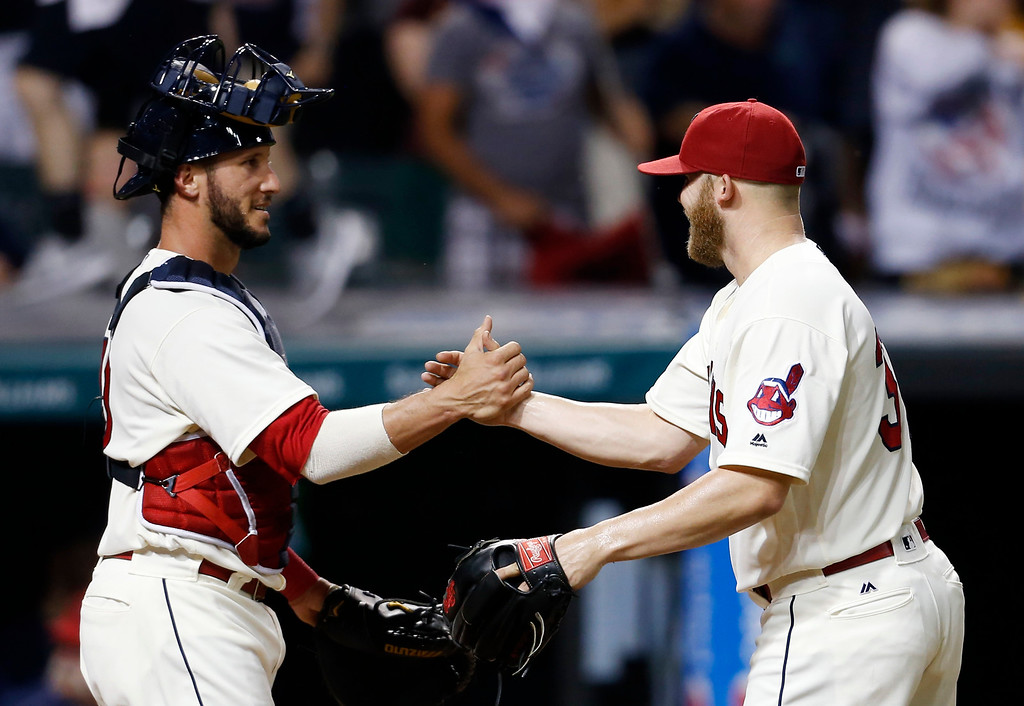 . Cleveland Indians relief pitcher Cody Allen, right, celebrates with Yan Gomes after the Indians defeated the Tampa Bay Rays 7-4 in a baseball game, Monday, June 20, 2016, in Cleveland. (AP Photo/Ron Schwane)