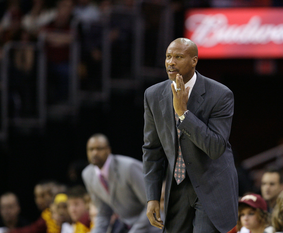 . Cleveland Cavaliers head coach Byron Scott yells to teammates in an NBA basketball game against the Toronto Raptors Monday, Dec. 26, 2011, in Cleveland. (AP Photo/Tony Dejak)