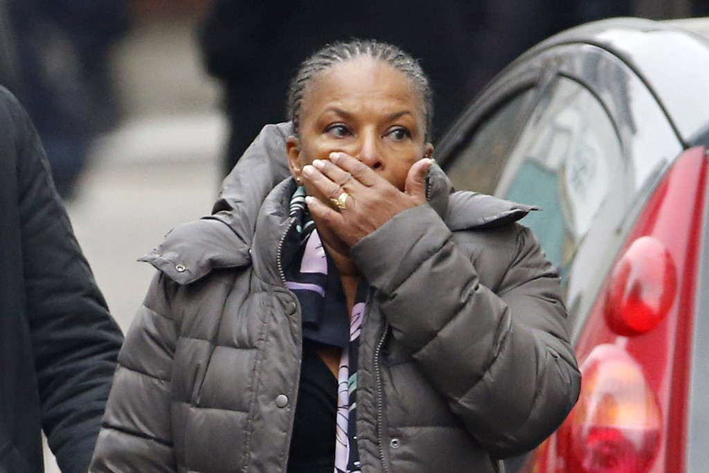 . French Justice Minister Christiane Taubira reacts outside of the headquarters of the French satirical newspaper Charlie Hebdo in Paris on January 7, 2015, after armed gunmen stormed the offices leaving twekve dead. At least 12 people were killed when gunmen armed with Kalashnikovs and a rocket-launcher opened fire in the offices of French satirical weekly Charlie Hebdo on January 7. AFP PHOTO / KENZO TRIBOUILLARD/AFP/Getty Images