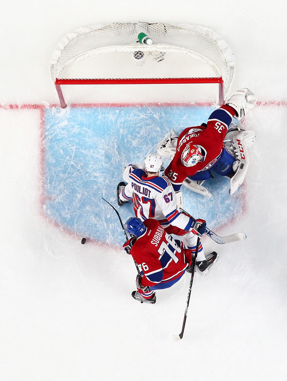 . Dustin Tokarski #35 of the Montreal Canadiens defends the net against Benoit Pouliot #67 of the New York Rangers during Game Five of the Eastern Conference Final in the 2014 NHL Stanley Cup Playoffs at Bell Centre on May 27, 2014 in Montreal, Canada.  (Photo by Francois Laplante/FreestylePhoto/Getty Images)
