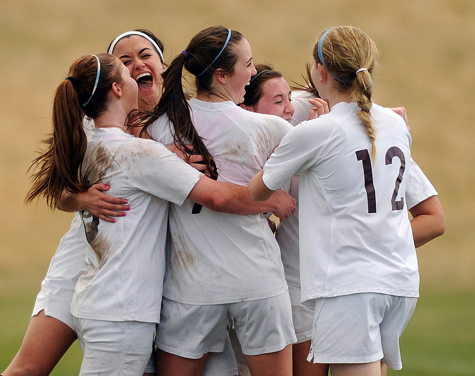 . PARKER, CO. - APRIL 2: The Demons celebrated after Katie Tubbs scored from long distance in the second half. The Valor Christian High School girl\'s soccer team defeated Golden 4-1 Wednesday night, April 3, 2013.  Photo By Karl Gehring/The Denver Post)