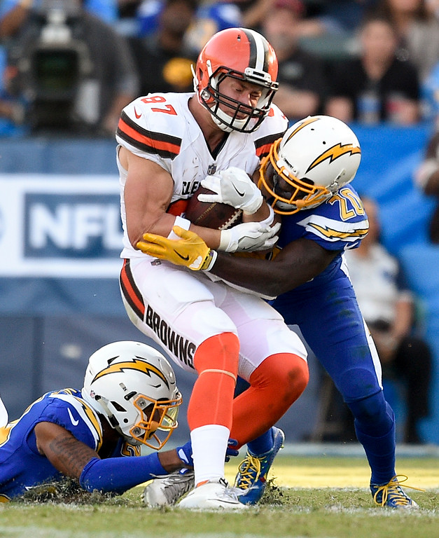 . Cleveland Browns tight end Seth DeValve is tackled by Los Angeles Chargers defensive back Desmond King, right, during the second half of an NFL football game Sunday, Dec. 3, 2017, in Carson, Calif. (AP Photo/Kelvin Kuo)