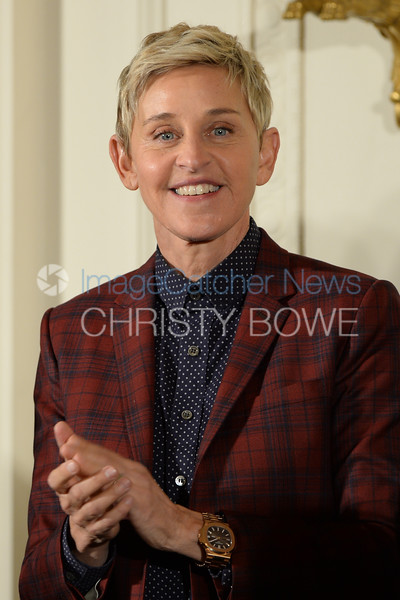 Actress/talk show host Ellen DeGeneres awaits her turn to receive the Presidential Medal of Freedom in a ceremony in the East Room.