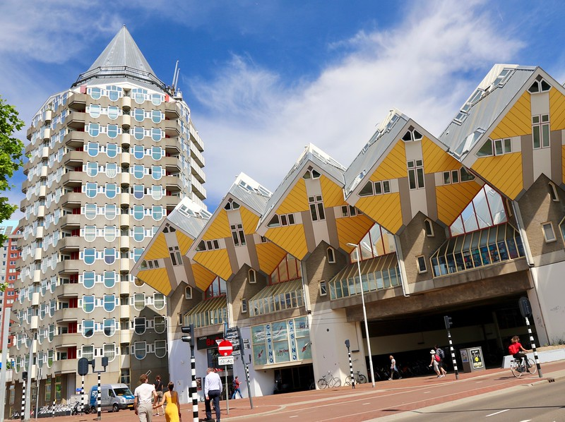 The building on the left is called The Pencil and the yellow ones are called Cube Houses and are ACTUALLY houses! Built in the late 70s, there are 39 identical cubes. Each house has 3 floors and is about 1100 sq. ft. - Rotterdam
