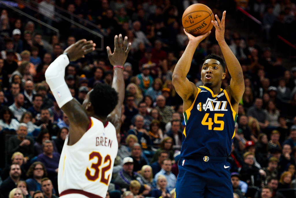 . Utah Jazz guard Donovan Mitchell (45) shoots over Cleveland Cavaliers forward Jeff Green (32) in the second half of an NBA basketball game Saturday, Dec. 30, 2017, in Salt Lake City. (AP Photo/Alex Goodlett)