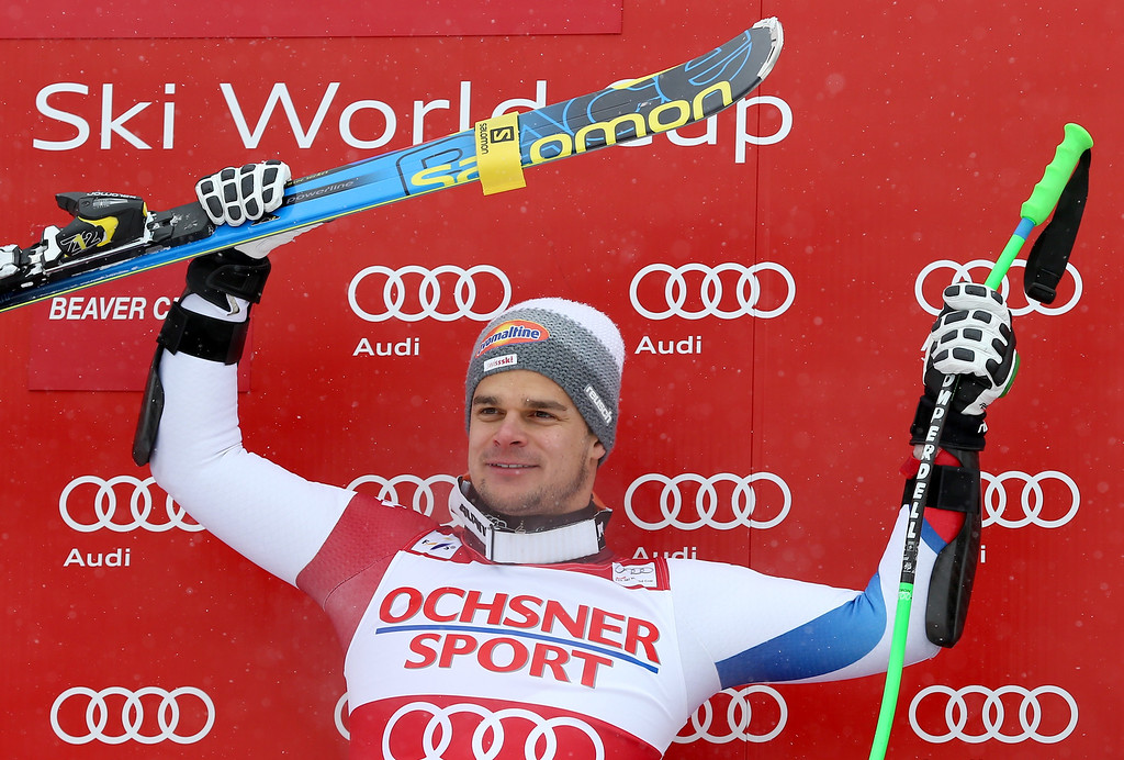 . Switzerland\'s Patrick Kueng raises his arms on the podium after winning the men\'s World Cup super-G skiing event, Saturday, Dec. 7, 2013, in Beaver Creek, Colo.(AP Photo/ Alessandro Trovati)