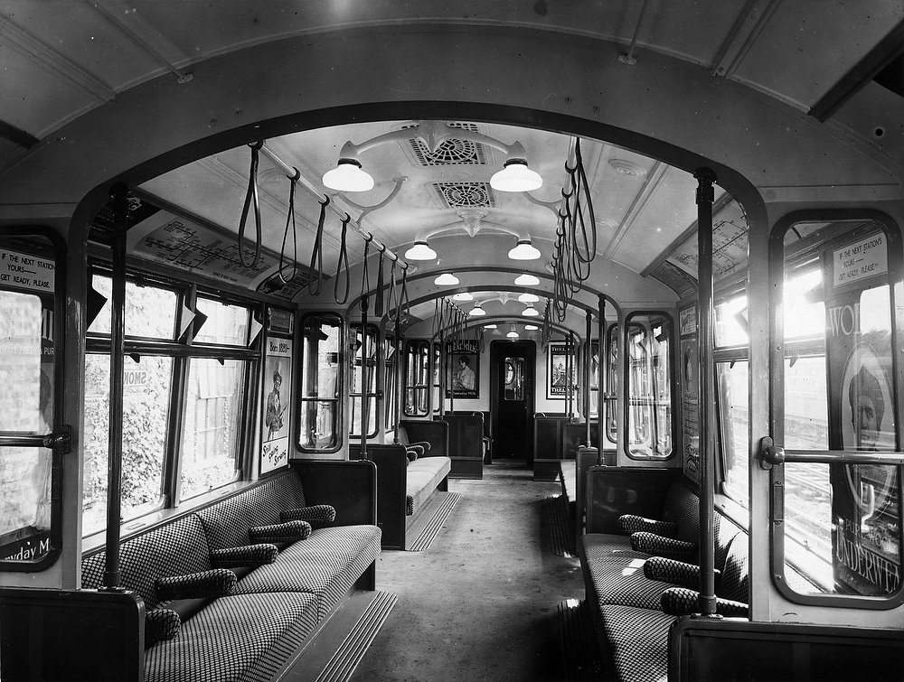 Description of . Interior of an all-steel London underground train  circa 1920.  (Photo by Topical Press Agency/Getty Images)