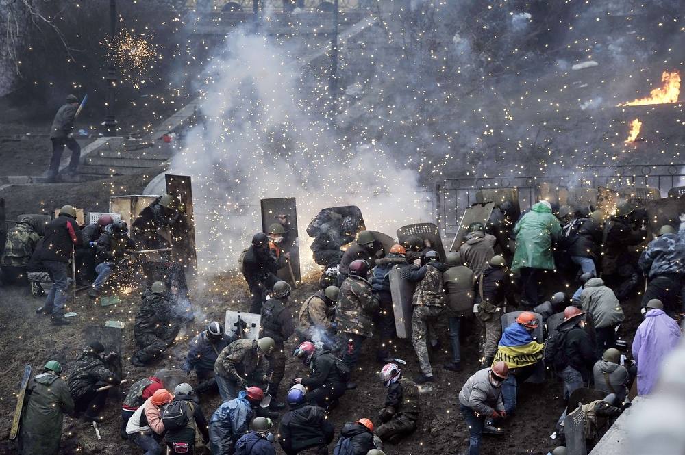 Description of . Protesters clash with police after gaining new positions near the Independence square in Kiev on February 20, 2014. Hundreds of armed protesters charged police barricades Thursday on Kiev's central Independence Square, despite a truce called just hours earlier by the country's embattled president. Protesters pushed the police back about 200 metres and were in control of most of the square they had occupied at the start of Ukraine's three-month-old political crisis.  LOUISA GOULIAMAKI/AFP/Getty Images