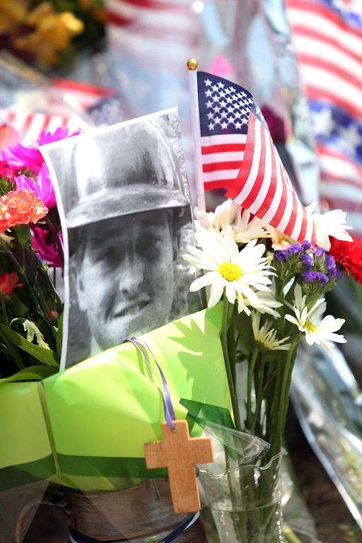 . A fallen firefighter\'s picture is part of a memorial outside of the Granite Mountain Hotshot fire station in Prescott, Arizona July 1, 2013.    Krista Kennell/AFP/Getty Images
