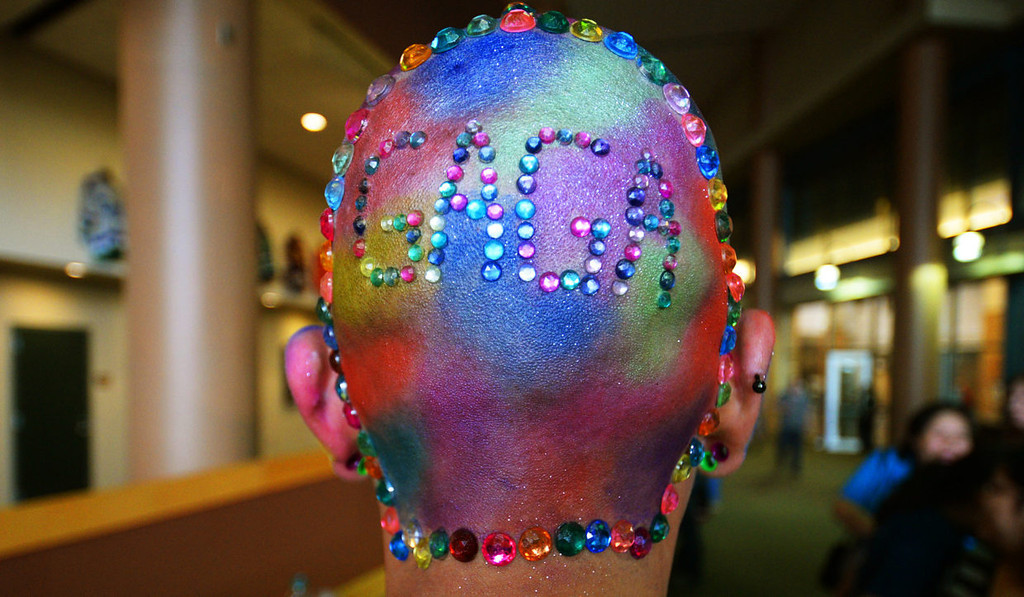 . Jesse Wetzel from Eau Claire, Wis., demonstrates his loyalty to Lady Gaga by spelling out Gaga in sequins on the back of his head. He was photographed in line prior to the start of the Lady Gaga concert at Xcel Energy Center in St. Paul, Tuesday, May 20, 2014.  (Pioneer Press: John Autey)