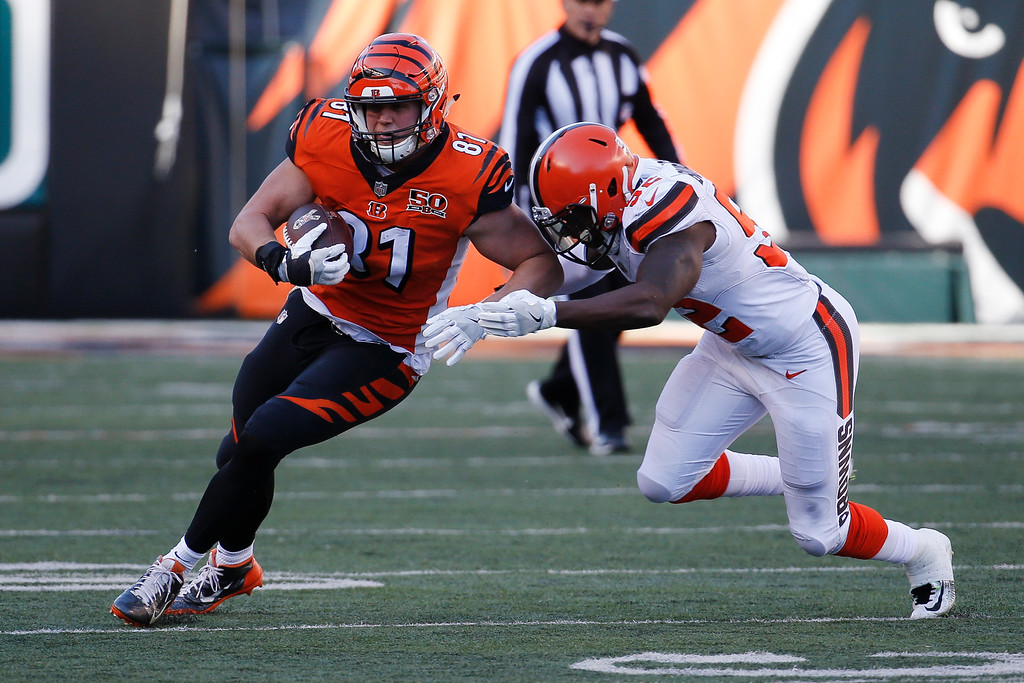 . Cincinnati Bengals tight end Tyler Kroft (81) runs the ball against Cleveland Browns outside linebacker James Burgess (52) in the second half of an NFL football game, Sunday, Nov. 26, 2017, in Cincinnati. (AP Photo/Frank Victores)