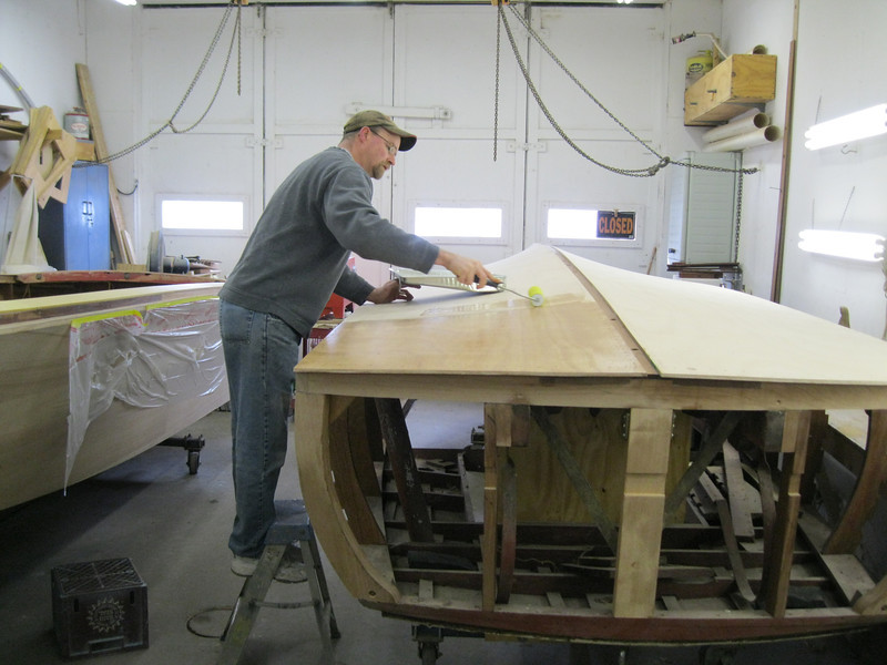 Applying epoxy to the bottom so the second bottom layer can be attached.