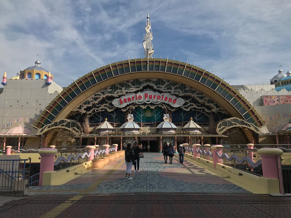 Crossing the bridge to Sanrio Puroland. You'll hear cheery theme park music, much like Disneyland.
