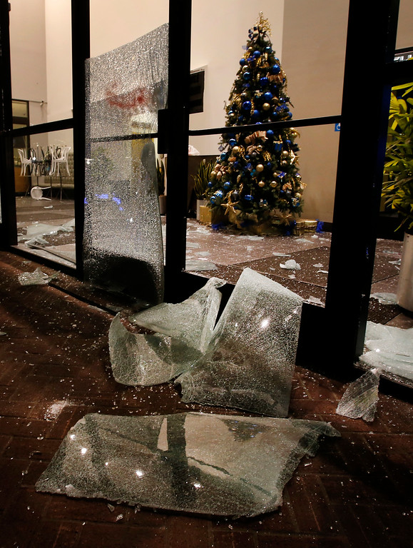 . A trail of broken glass is left by protesters along Shattuck Avenue, including at this Chase Bank branch in Berkeley, Calif., late Sunday evening, Dec. 7, 2014, during a second consecutive night of unrest in the city over the killings of two unarmed black men by police in Ferguson, Mo., and New York. (Karl Mondon/Bay Area News Group)