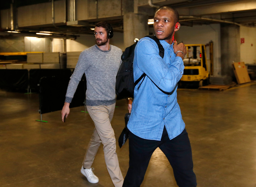 . Cleveland Cavaliers guard James Jones, foreground, and forward Kevin Love arrive before the start of an NBA basketball game against the Miami Heat, Monday, April 10, 2017, in Miami. (AP Photo/Wilfredo Lee)