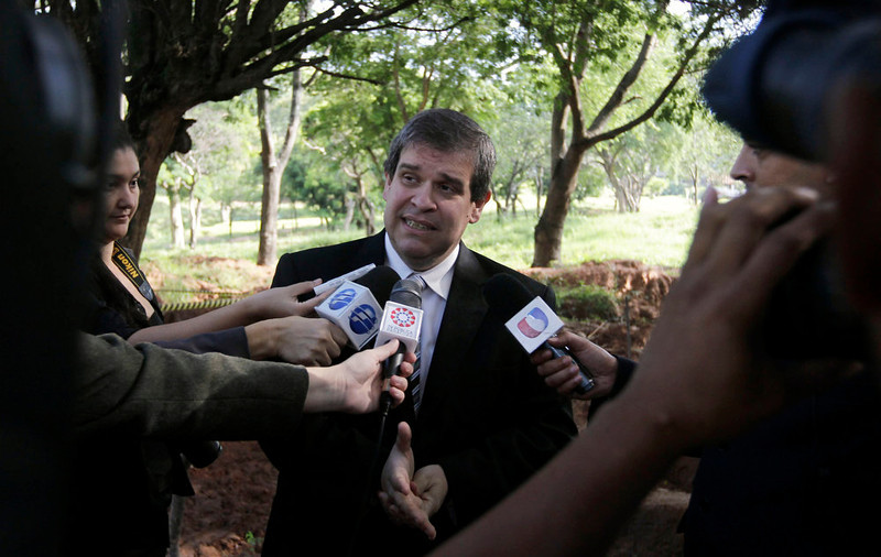 . Paraguay\'s Finance Minister Manuel Ferreira speaks at the excavation site of human remains discovered in the grounds of a police barracks in Asuncion, Paraguay on March 21, 2013. According to the researchers, 15 more skeleton remains, likely to be victims of the 1954 to 1989 dictatorship under Alfredo Stroessner, were found in the last two days. REUTERS/Jorge Adorno